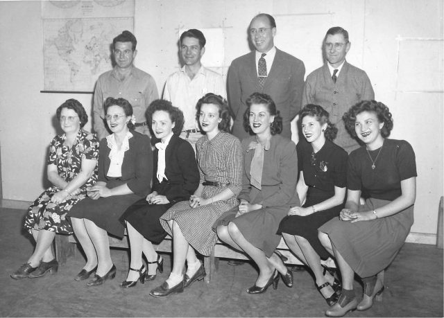 "Work picture in 1945 at the Utah ASE Depot, Ogden, UT. Front row, left to right: Boston, [lady], Norma (Boston's neice). See <a href=""http://richmanfamily.org/wp-content/uploads/Boston-work-picture-Norma-1945-info.jpg"">information from back of photo</a>."