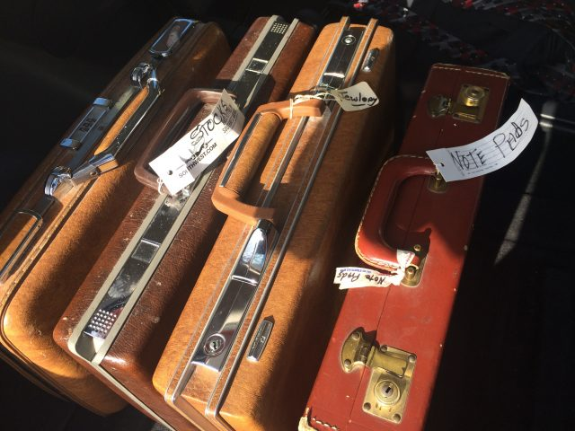 A few of Lynn's dozens of briefcases full of book work, etc.