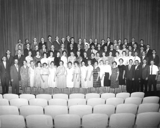 Lynn's high school reunion. Lynn is 8th from the right on the 3rd row. Glen Seely is back row 4th from the left