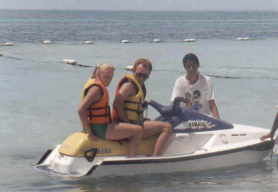 Jamie and Dad on a waverunner in Cancun, Mexico 1999