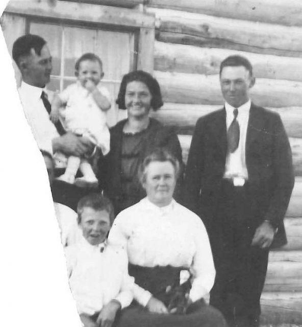 Log cabin homestead in Malta, Idaho. Left to right (back row): Grace Emily (age 20), John Henry (age 26), Janie (age 1), Lora Harmon T. (age 30), Edward Alva