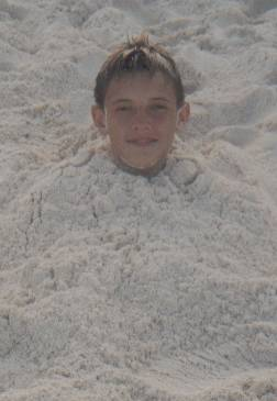 Buried in the sand on the beach at Cancun, Mexico in 1999