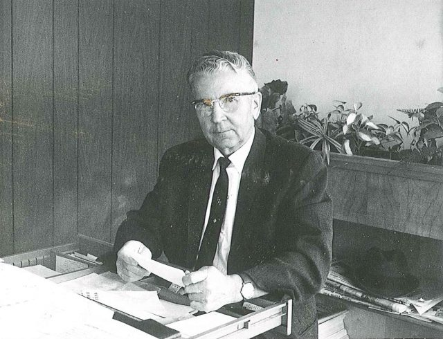 Francis Leland Seely in the office of Seely's Motel