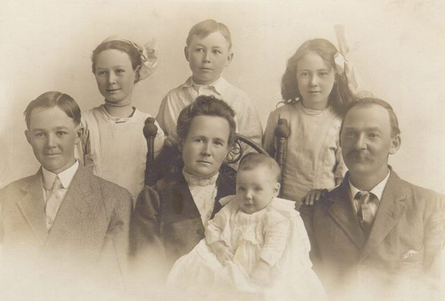 John Ernest Thompson family in Murray, Utah in 1912. Left to right (front row: John Henry (age 16), Jane Bosomworth (age 41), William Bosomworth (10 months), John Ernest Thompson (age 45); (back row): Jennie Louisa (age 12), Edward Alva (age 8), Grace Emily (age 10).
