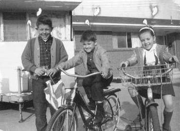 Larry, Rick, Joy on bikes at the Granger house