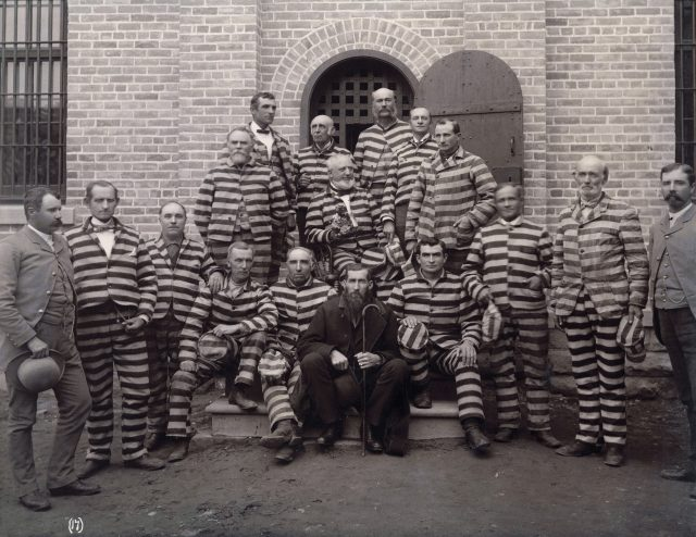 "This photo may or may not include Thomas Lorenzo Obray. See <a href=""https://commons.wikimedia.org/wiki/File:Polygamists_in_prison.jpg"">photo and description in Wikipedia</a>"