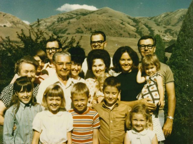Seely and Richman families in Brigham City (outside the Seely home). Left to right (back row): Grace, Larry, Glen, Leland, Joyce, Ken, Gwen, Karen, Brandy, Jim; (front row): Joy, Linda, Mike, Rick, Kathy