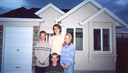 Kids and playhouse that Rick built, modeled after their house, November 2001
