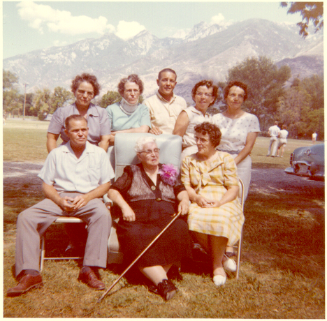 Sarah Ellen Lambson Samuelson's 80th birthday celebration. Back Row (left to right): Carrie Samuelson Ferera, Mary Frieda Samuelson Frandsen, Almon Marion Samuelson, Emma Euleda Samuelson, Thora Samuelson Fackrell; front row (left to right): John Alfred Samuelson, Sarah Ellen Lambson Samuelson, Mildred Matilda Jackman